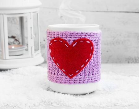 valentine day cup of coffee: Hot Chocolate Steaming in Mug with Wool Knitted Cloth and Heart Shape in the Winter Time
