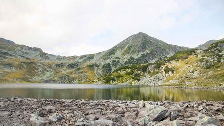 glaciar: Beautiful landscape with mountain peak and glaciar lake on cloudy weather Stock Photo
