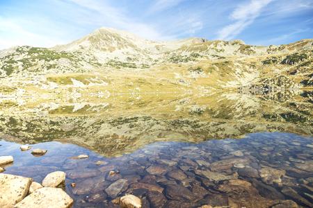 glaciar: Beautiful landscape with mountain peak and glaciar lake reflecting the mountain