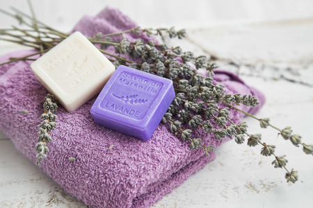 Spa setting with towel and marseille lavender soap,dried lavender