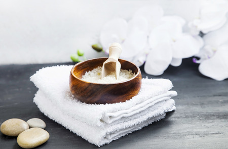 relaxation background: Spa still life setting with spa stones,bath salt and white towels