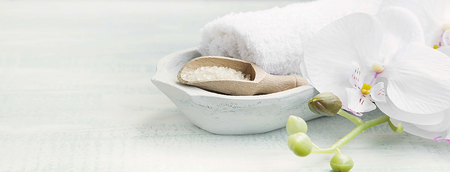 white towels: Spa still life setting with white orchid,bath salt and white towels