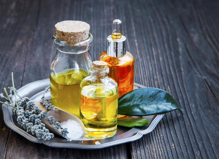 green background: Spa and aromatherapy oils for wellness, face and bodycare massage oils treatment