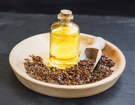flax seed oil: Flax seed oil in transparent bottle with flax seeds