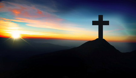 Christianity concept with christian cross silhouette on the hill on sunset Archivio Fotografico