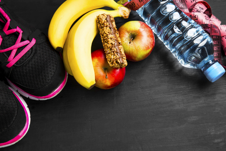 cereal bar: Heathy lifestyle with training shoes, fruits, cereal bar, water bottle