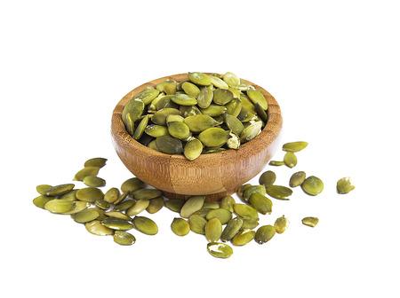 pumpkin seed: Pumpkin seed in bamboo bowl isolated