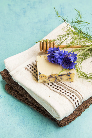 natural soap: Natural soap with cornflower on cotton towels, spa products Stock Photo