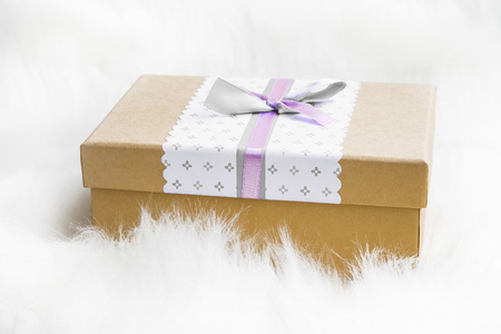 faux: Festive Christmas gift decorated with ribbon and bow in soft faux fur Stock Photo