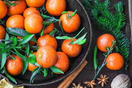 gir: Clementines fruits with winter spices and fir tree branches