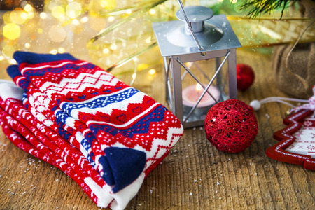 Christmas decoration setting with woolen festive socks, lantern , balls, tree and lights