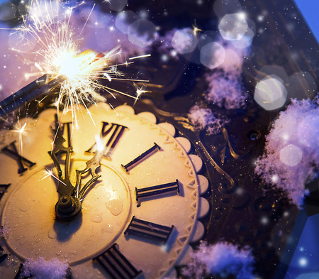 12 year old: Happy new year eve celebration with old clock showing 12 in the midnight and festive fireworks Stock Photo