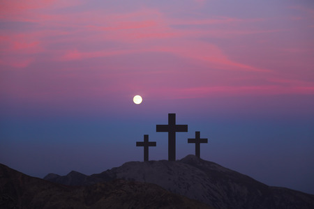 Crosses on the hill over sunset background.Religious concept of crucifixion