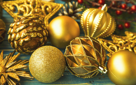 retro christmas: Vintage Christmas golden balls and decorations on painted old wooden board, festive decorations greeting, winter holidays season mood concept with Christmas balls background