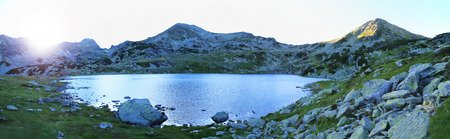 Mountain panorama with peaks and glacial lake at sunset, Carpathian Mountains