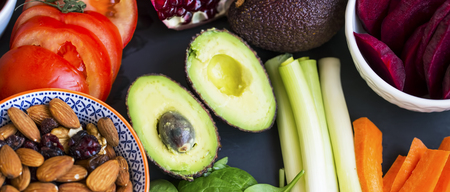 Healthy food selection top view with avocados, raw veggies, green leaves spinach, herbs and ingredients, mix of nuts, clean eating, healthy vegan food concept Standard-Bild - 118387758