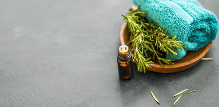 Rosemary spa still life with oil, herb and towel, spa still life and wellness setting with aromatherapy herbal rosemary oil Standard-Bild - 118387808