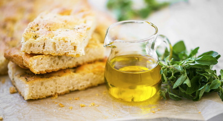 Foccacia bread with oregano herb and olive oil.Fresh italian foccacia bread closeup with mediterranean ingredients Standard-Bild - 118387849