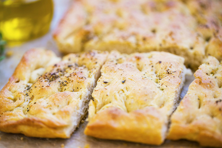 Focaccia bread with oregano and olive oil.Fresh italian foccacia bread closeup with mediterranean ingredients Standard-Bild - 118387851