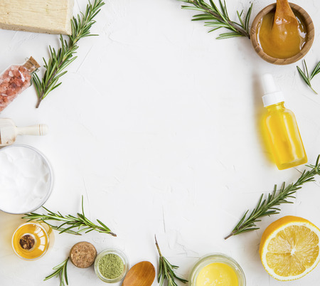 Natural skincare ingredients with manuka honey, lemon, essential oil, clay, balm, rosemary herbs and natural soap, healthy wellness and spa products , natural and homemade ingredients with copy space top view Standard-Bild - 118917404