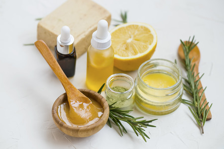 Natural skincare ingredients with manuka honey, lemon, essential oil, clay, balm, rosemary herbs and natural soap, healthy wellness and spa products , natural and homemade ingredients Standard-Bild - 118917408