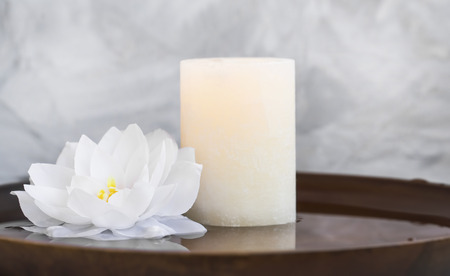 Spa still life with candle and water lily, spa still life composition natural wellness still life with candle and lotus in water background Standard-Bild - 118917184