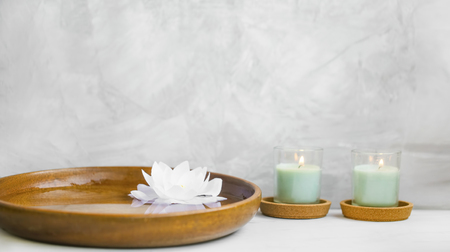 Spa still life with candles and water lily, spa still life composition natural wellness still life with candles and lotus in water background Standard-Bild - 118917186