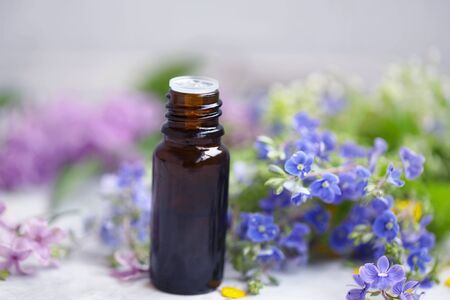 Flowers essential oil bottle, beauty and aromatherapy treatments ingredients, natural botanical herbs, alternative medicine