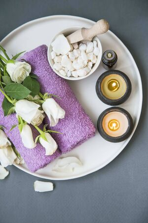 Spa still life with candles, bath salt and towels