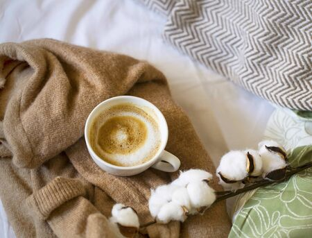 Autumn or winter indoor still life with coffee cup on cashmere cardigan , home still life Imagens