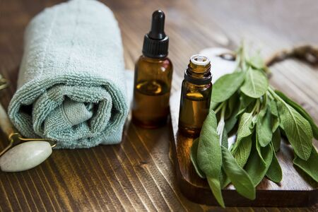 Spa still life setting with sage oil and plant Imagens