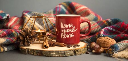 Autumn coffee cup with candle, spices and blanket decorations on wooden board, cozy fall deco concept, home lifestyle warm coffee cup in autumn season Zdjęcie Seryjne