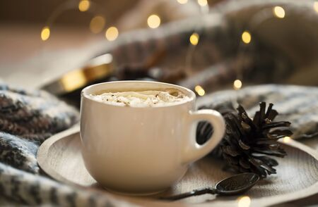 Coffee cup with cream, cozy festive setting with coffee and bokeh lights Stock fotó