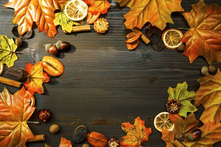 Autumn leaves frame composition with wooden copy space, top view of fall decorations with copy space