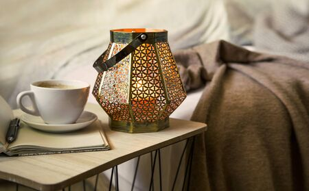 Home deco indoor with candle holder and coffee, cozy blanket ,cozy winter interior details Zdjęcie Seryjne
