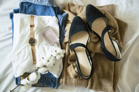 Casual female outfit idea with white t shirt, jeans , pointed ballet flats, cashmere cardigan, autumn outfit