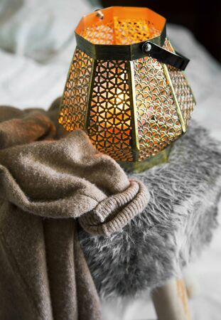 Home deco indoor with candle holder and cozy cashmere cardigan,cozy winter interior details