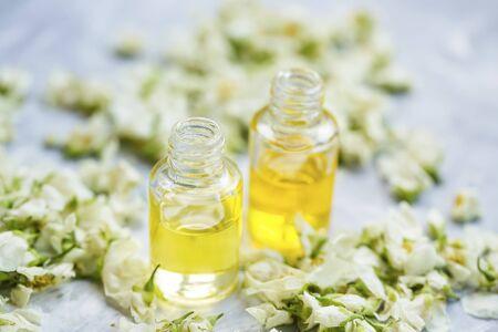 Jasmine essential oil bottles with dried jasmine flowers