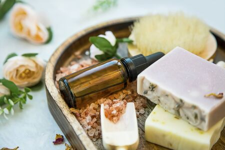 Spa still life setting with natural soaps and oil bottle, bath salt and roses, natural skincare, clean beauty Reklamní fotografie