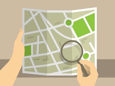 人間の手の考察のためのマップを保持している虫眼鏡を使用します。  イラスト・ベクター素材