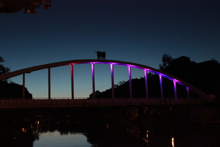 student climed a bridge top in Tartu Estonia