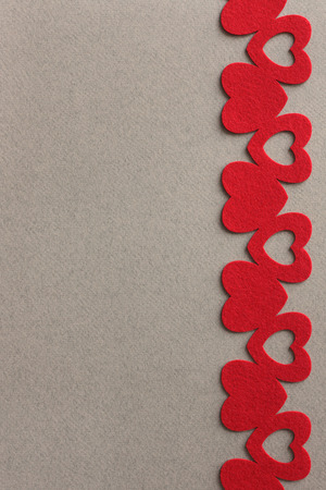 red felt hearts on grey paper background with space for inscription Stock fotó - 122200998