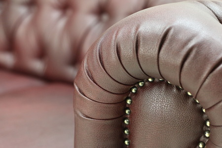 Seamless texture background close-up brown leather with button detail on furniture fabric without people people