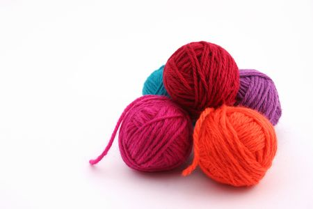withe background: Bright colored wool balls on withe background