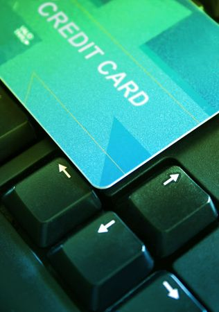 Credit card on a computer keyboard photo