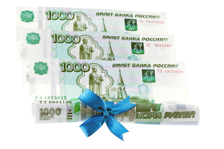 Ruble with gift bow isolated on white photo