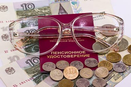 kopek: Pension certificate and glasses on a background of money Stock Photo