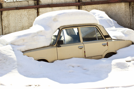 russian car: Old Russian car under snow in winter