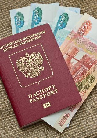 embedding: Russian passport with money on burlap background Stock Photo