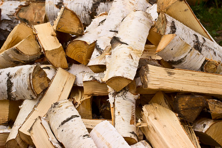 Pile of a birch firewood. Background